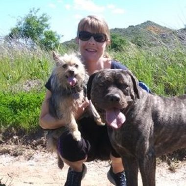 Emma, veterinary staff member, with her two dogs